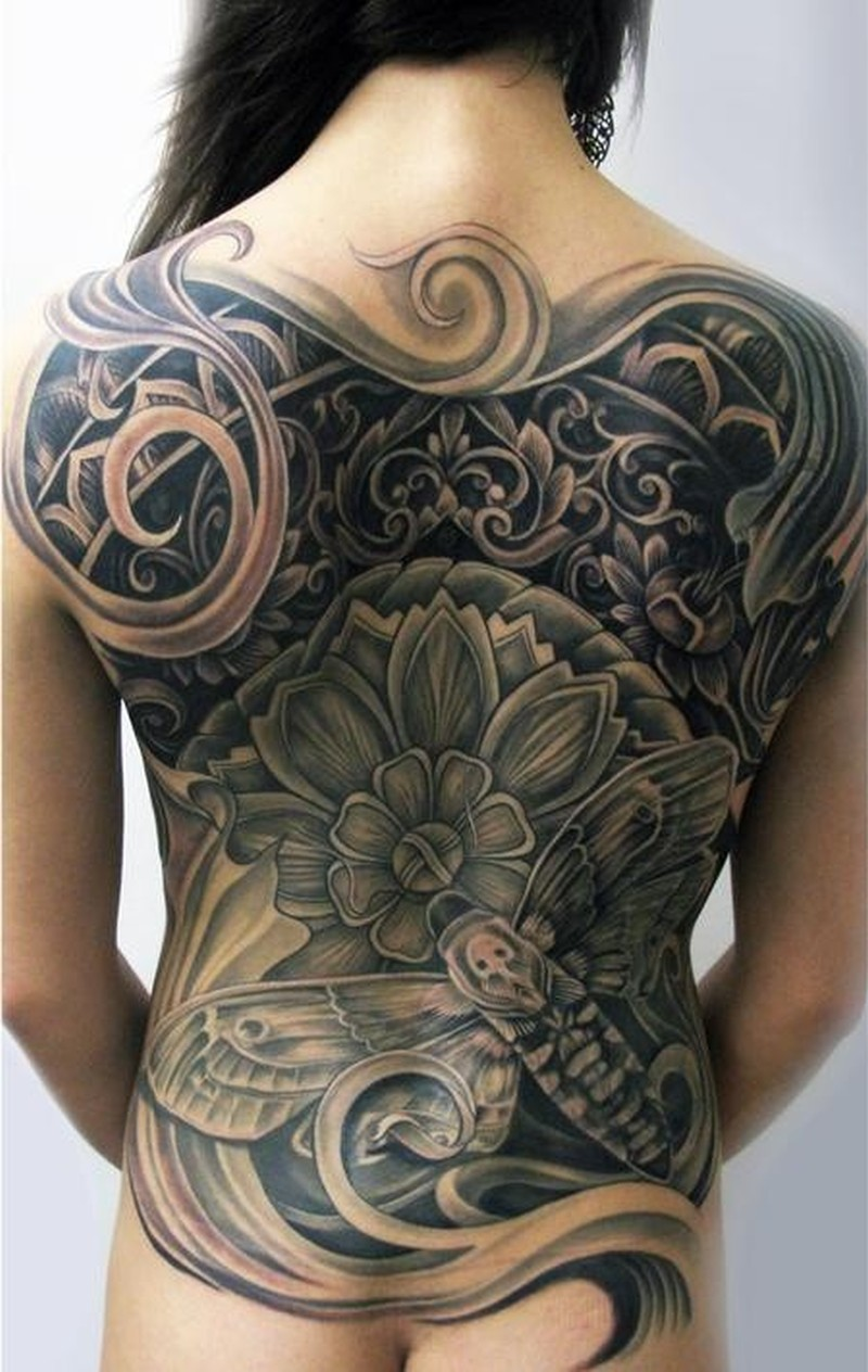 Awesome butterfly witn patterns tattoo on back for girls
