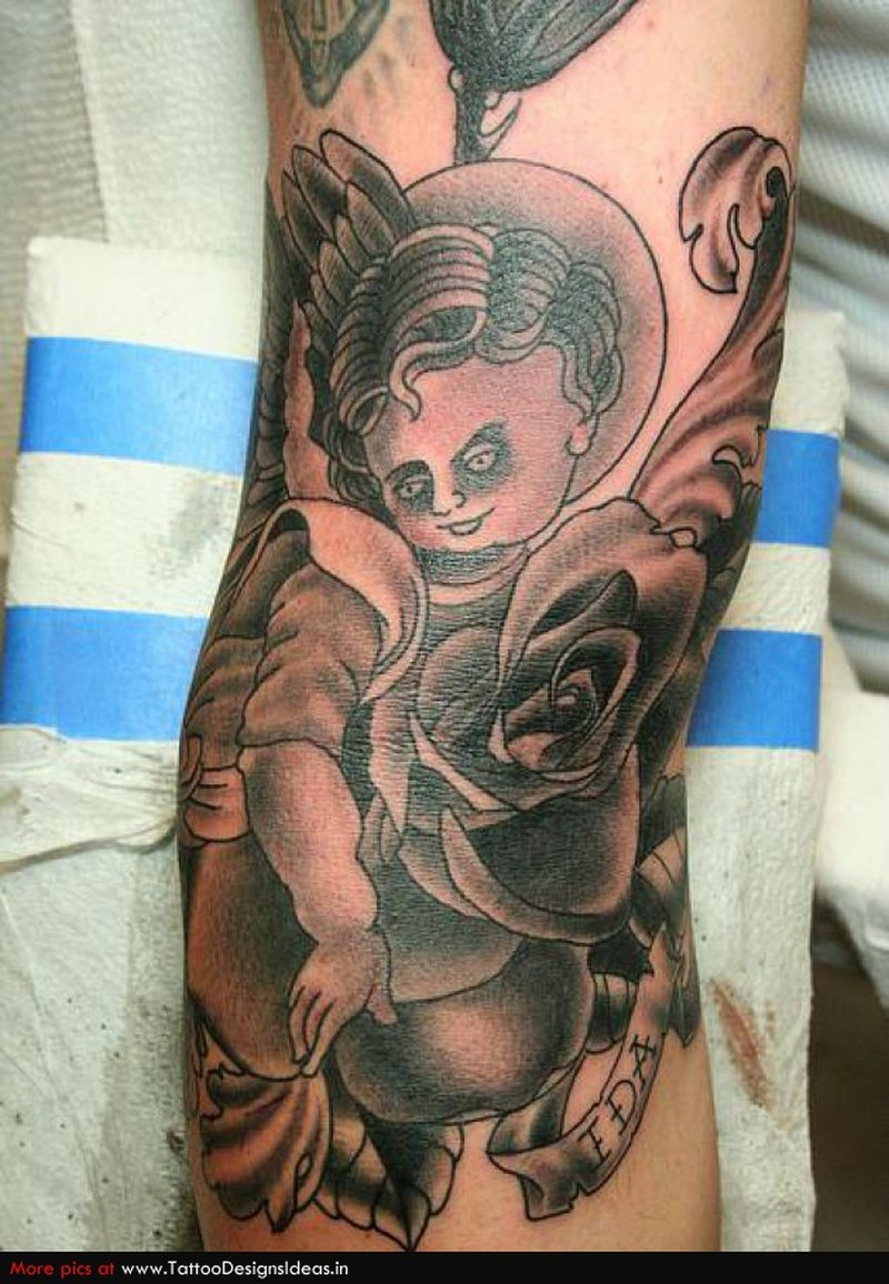 Awesome cherub tattoo design tattoos book for Baby s first tattoo book