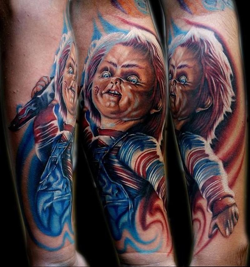 Awesome chucky movie horror tattoo on arm