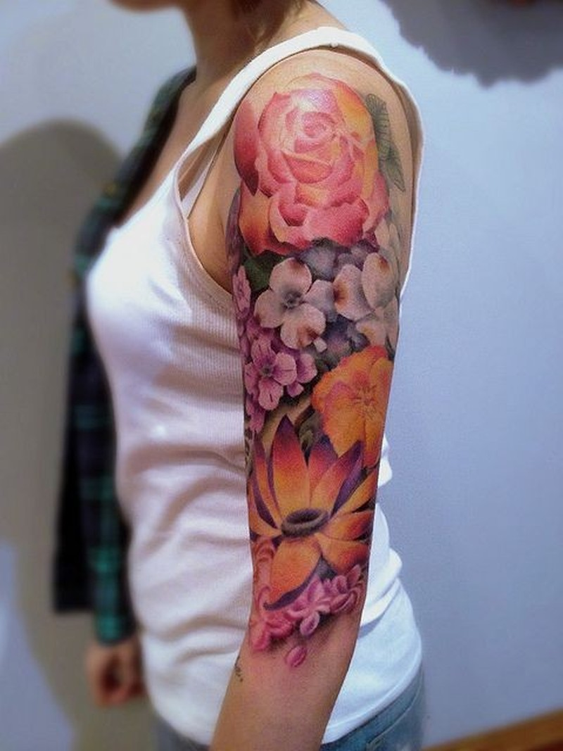 Awesome coloured flowers tattoo on half sleeve