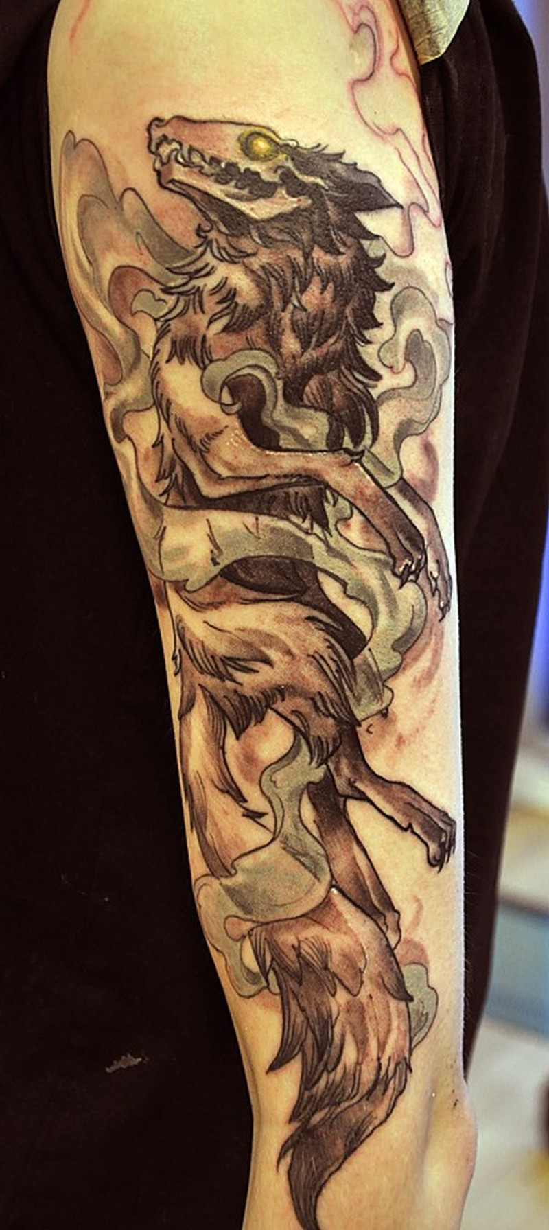 Awesome dead wolf tattoo on half sleeve