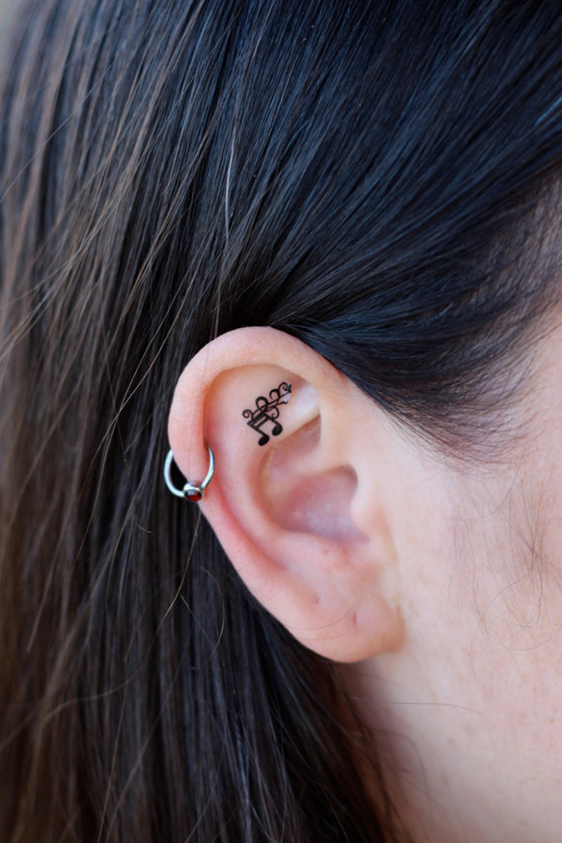 Awesome music notes tattoo on ear