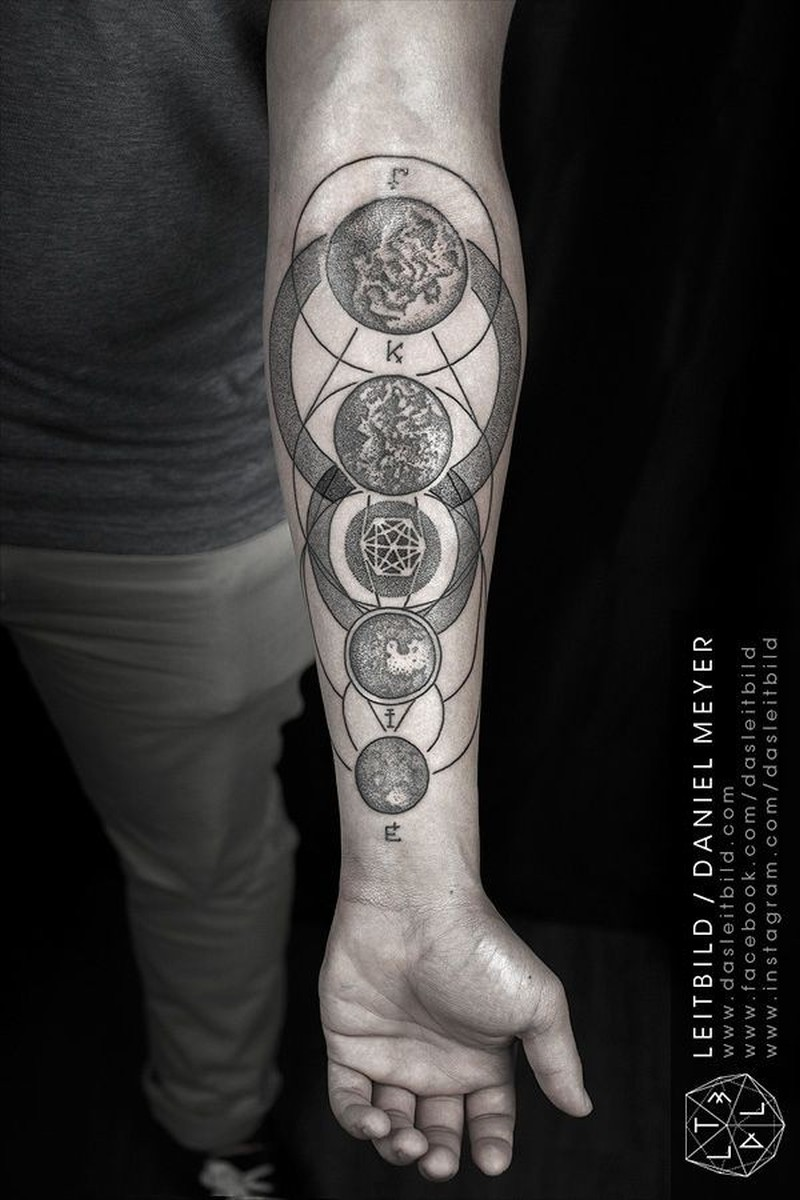 Awesome planets and geometrical symbols dotwork forearm tattoo by daniel meyer