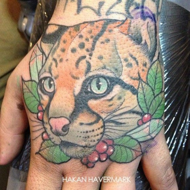 Awesome realistic head leopard tattoo by Hakan Havermark