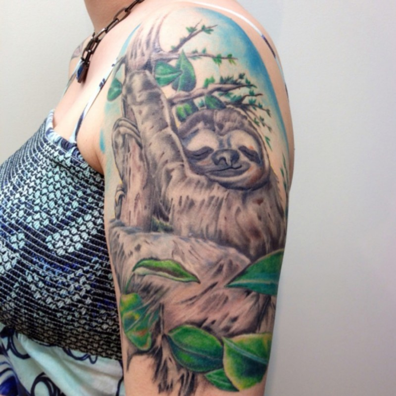 Awesome sleeping sloth tattoo on half sleeve