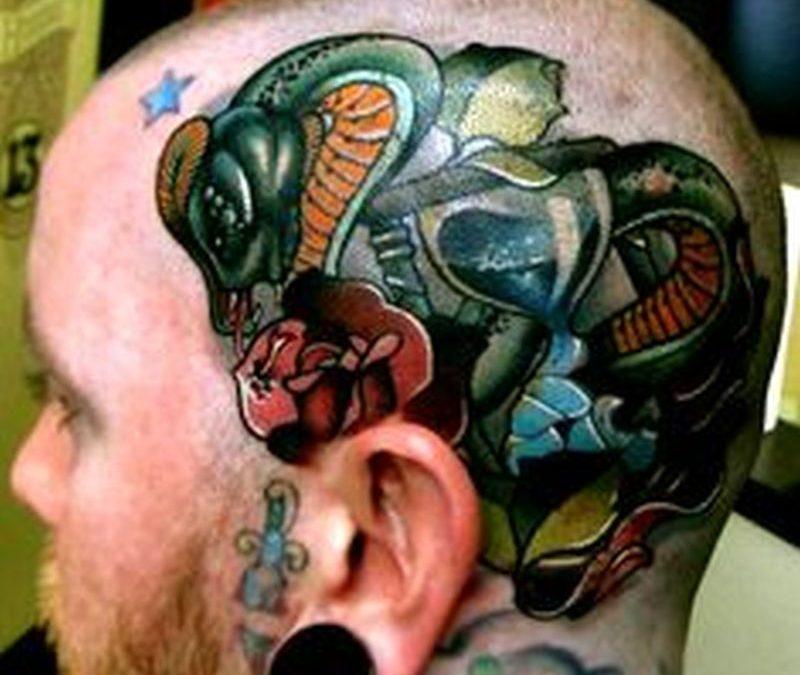 Awesome snake head tattoo
