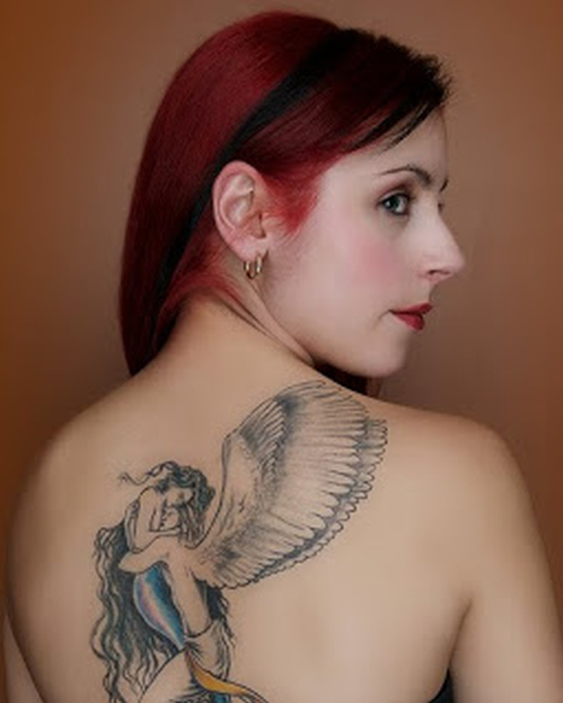 Awesome tattoo design of couple angel