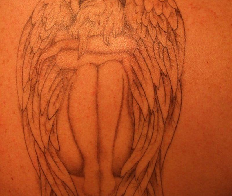 Awesome tattoo design of sad angel