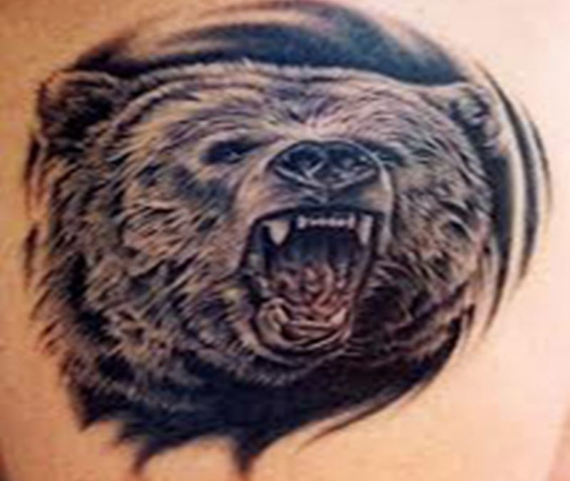 Awesome tattoo of angry bear face