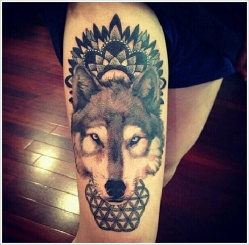 Awesome wolf with black pattern tattoo on thigh