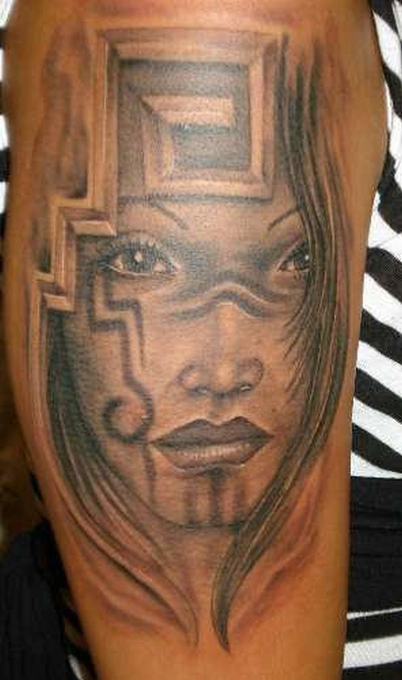 Aztec designs on arm tattoo