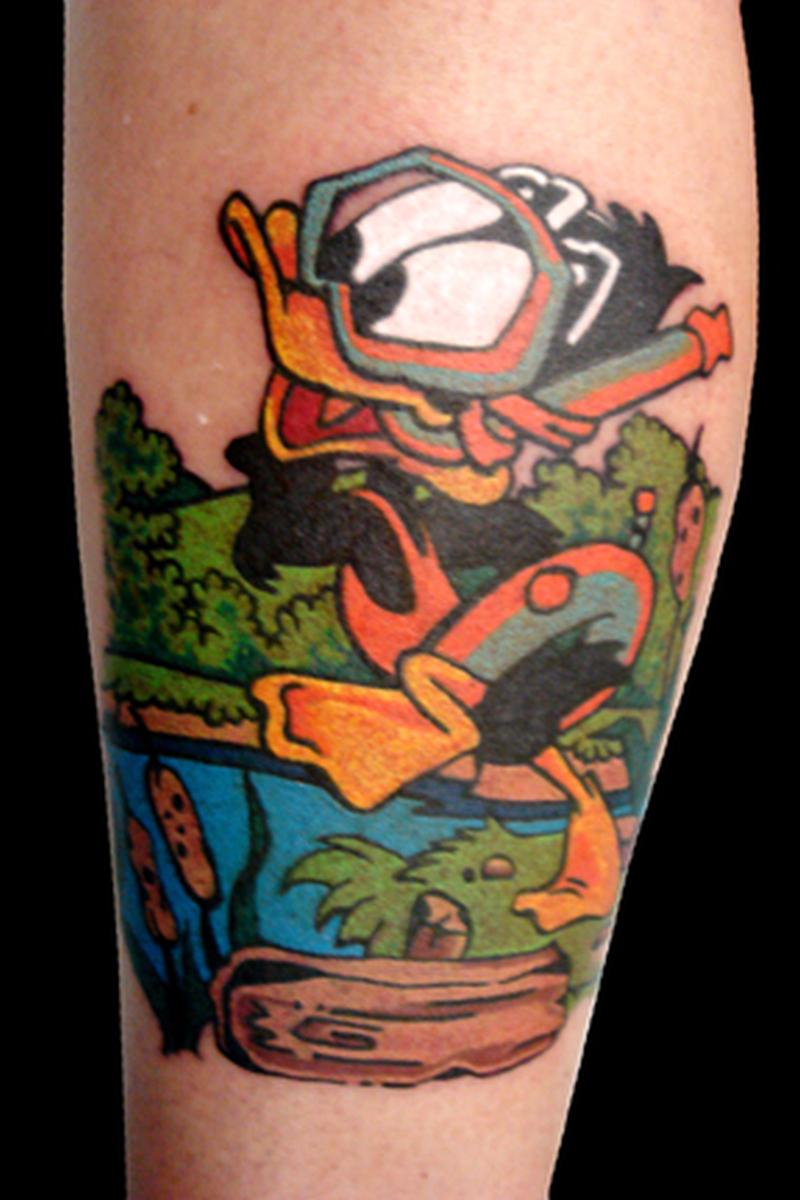 Baby daffy cartoon tattoo tattoos book tattoos for Cartoon baby tattoos