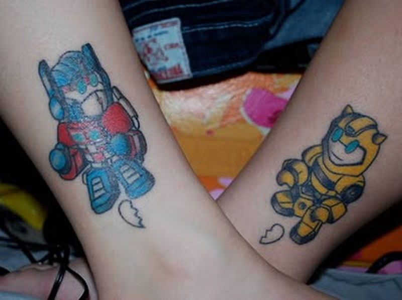 Baby optimus prime and bumble bee tattoo