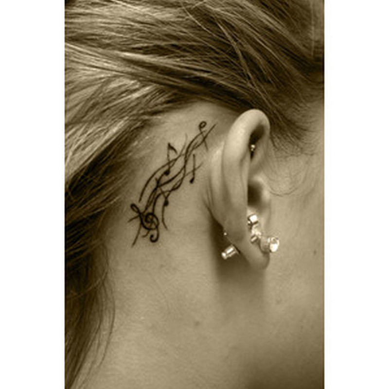 Back ear music notes tattoo for girls