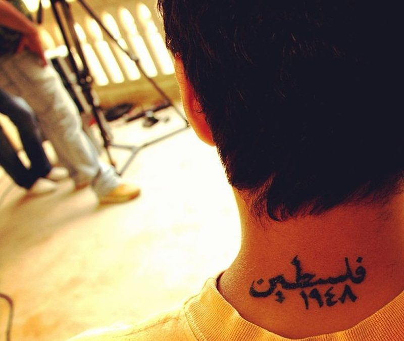 Back neck awesome arabic tattoo design