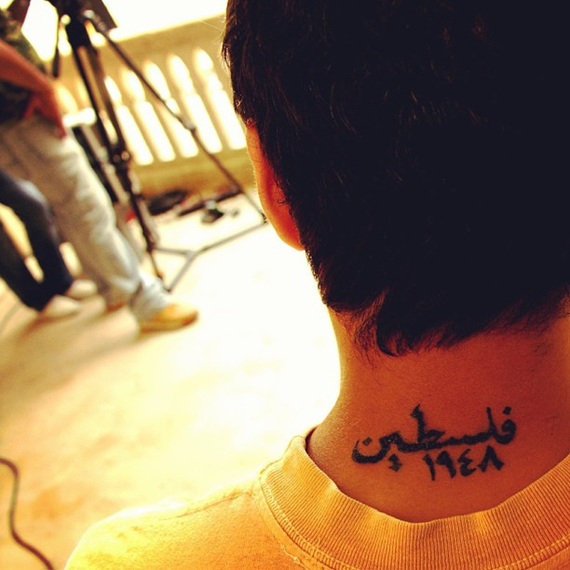 Back neck awesome arabic tattoo design