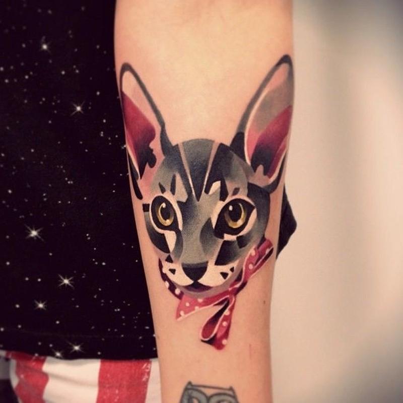 Baeutiful watercolor cat tattoo on arm