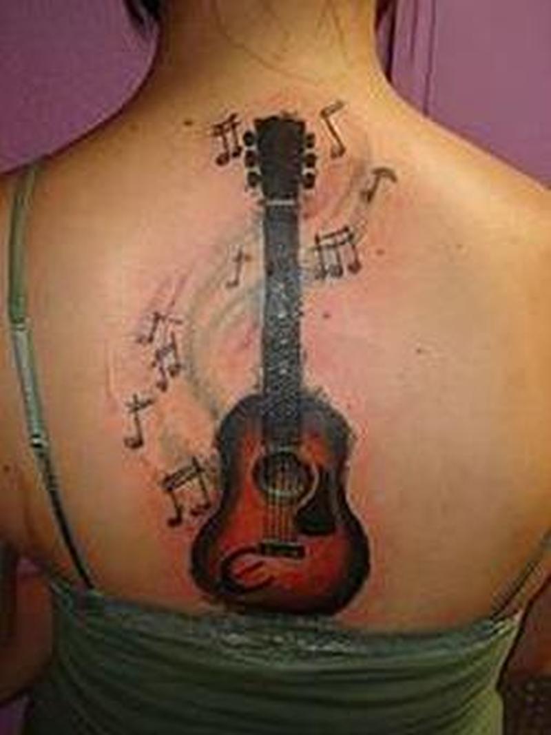 Band guitar with musical symbols tattoo design