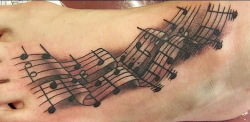 Band music symbol tattoo on foot