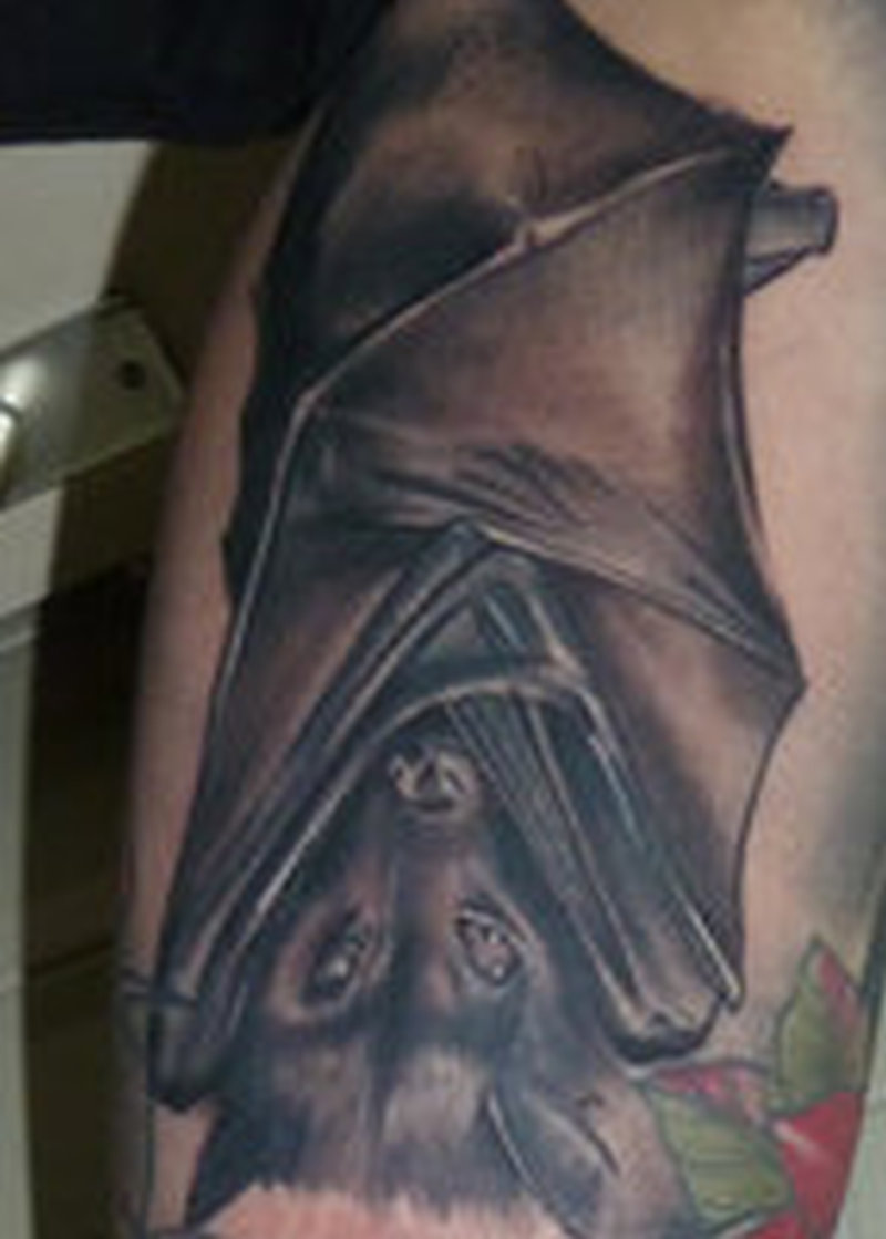 Bat covered by the wings amazing tattoo