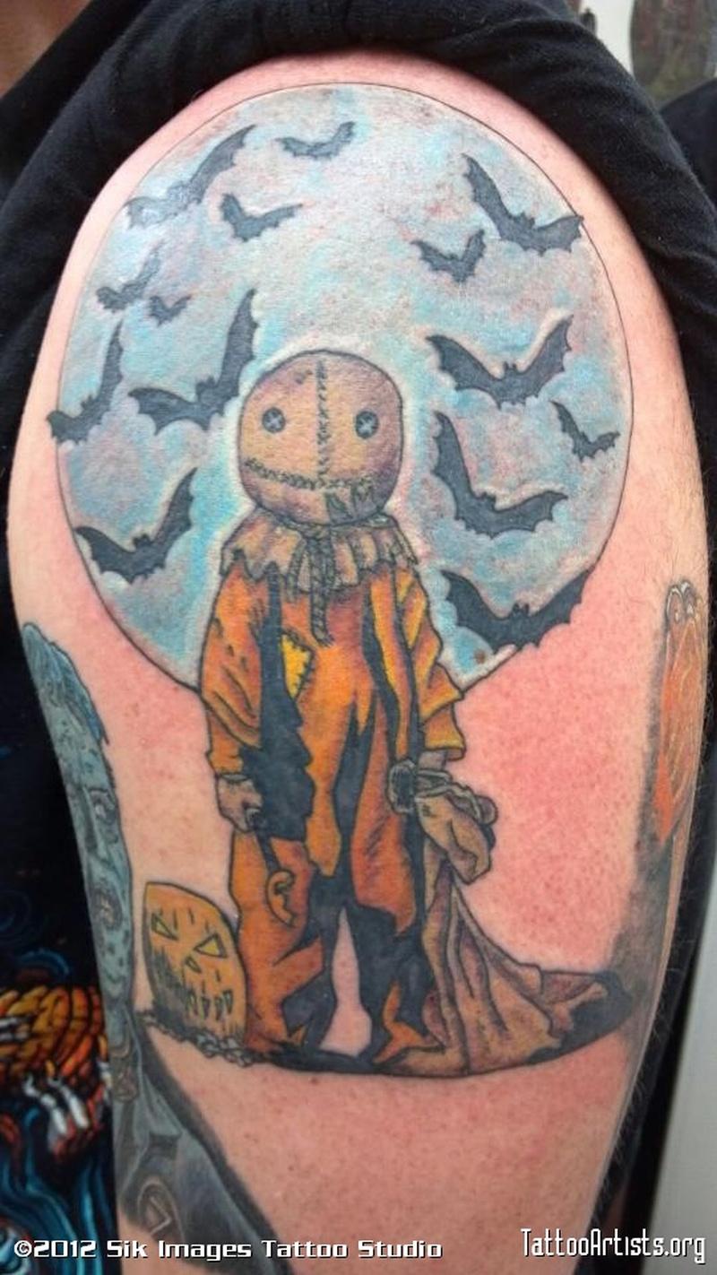 Bats n halloween tattoo on shoulder
