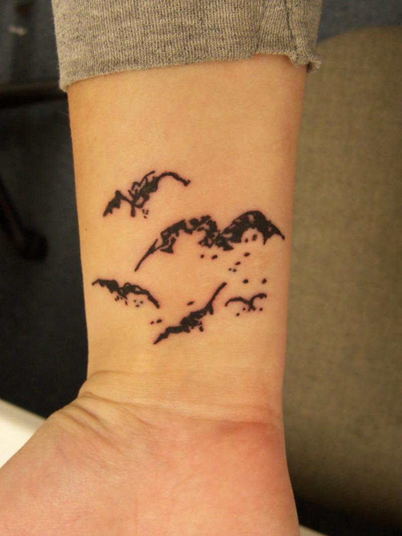 Bats tattoo design on wrist