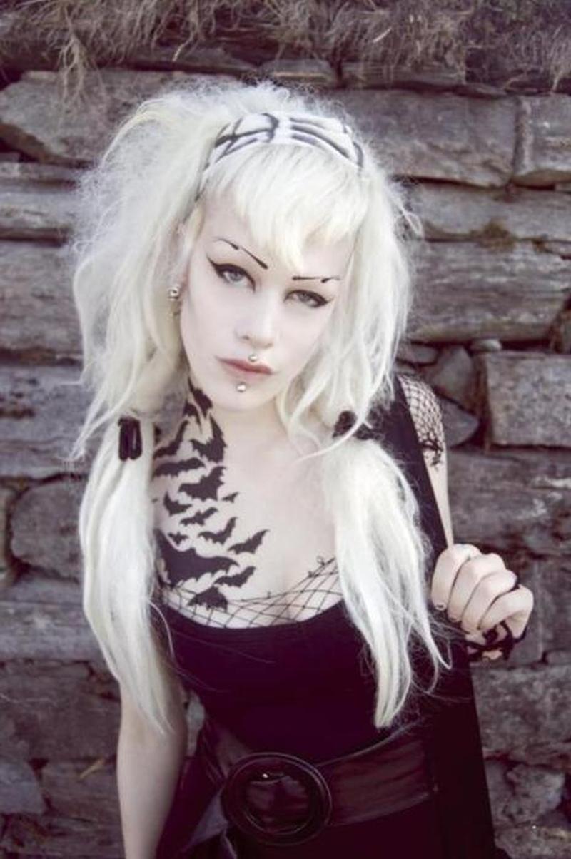 Bats tattoo on girls neck chest