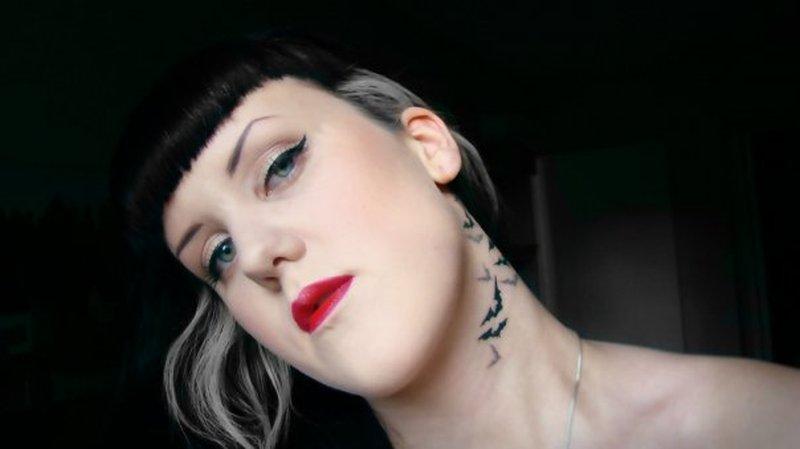 Bats tattoo on sexy girls neck