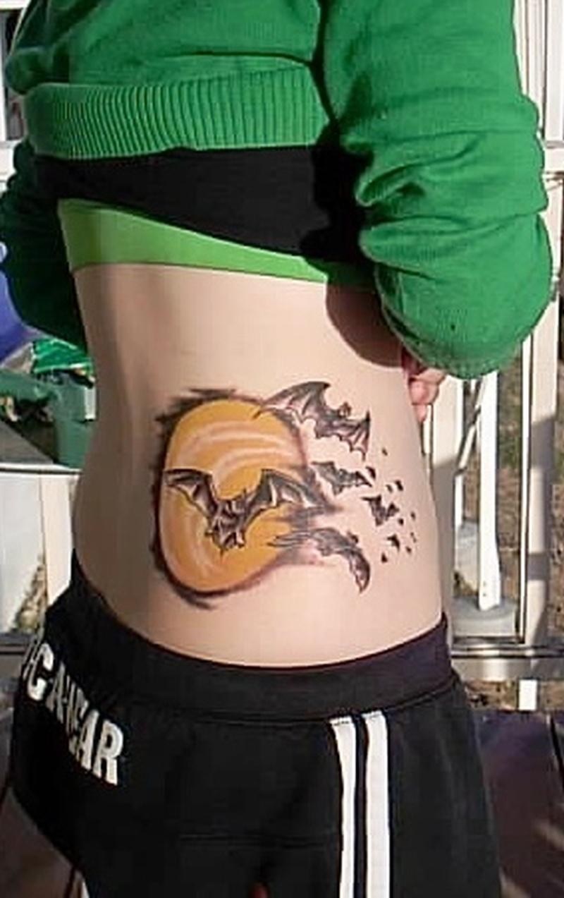 Bats tattoo on waist
