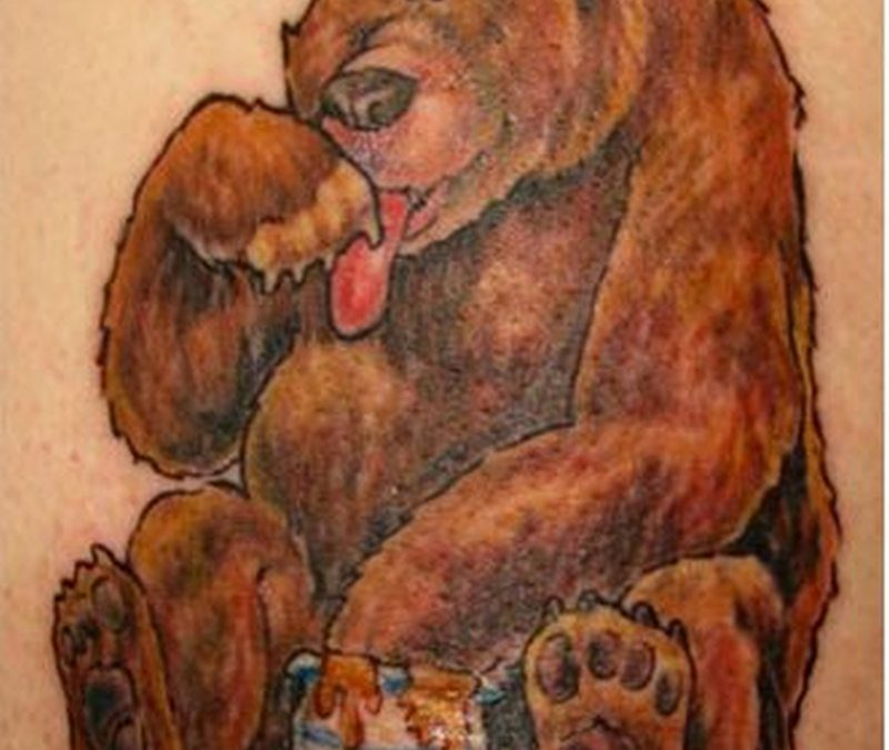 Bear eating honey tattoo