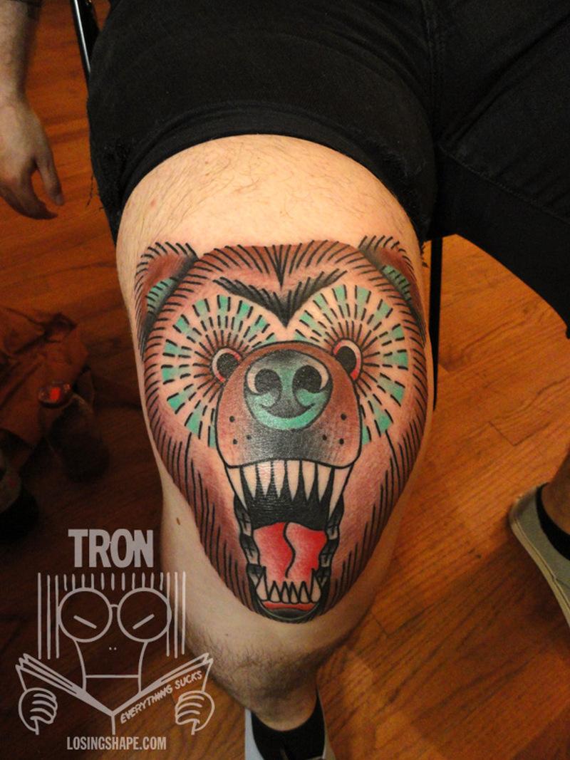 Bear head knee tattoo