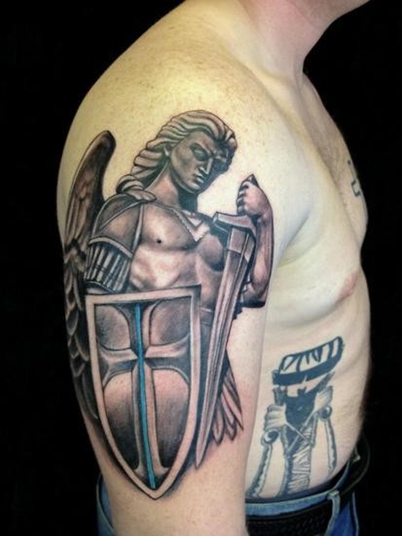 Beautiful archangel michael in armor tattoo on half sleeve