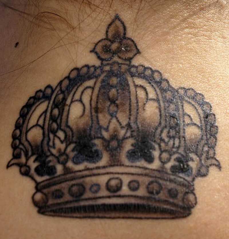 Beautiful crown on upper back for girls tattoo