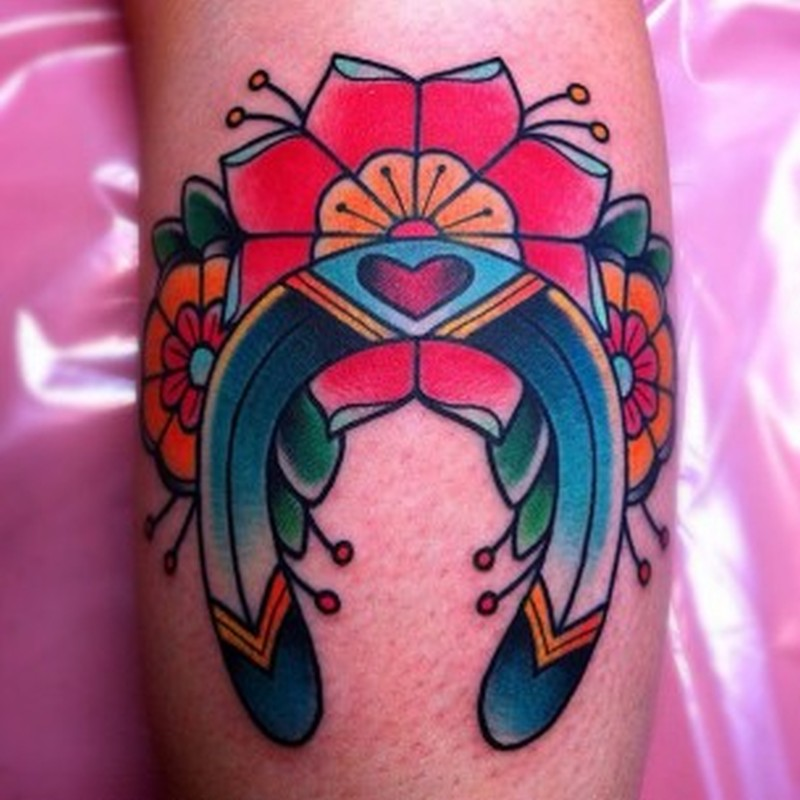 Beautiful horseshoe design tattoo