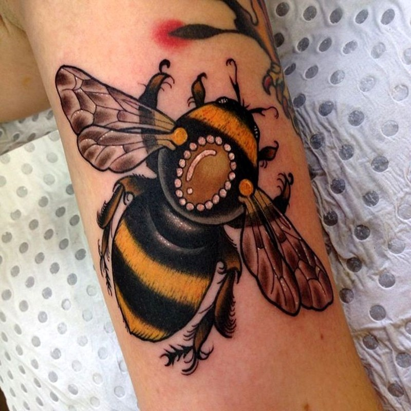 Beautiful realistic bumblebee tattoo on arm