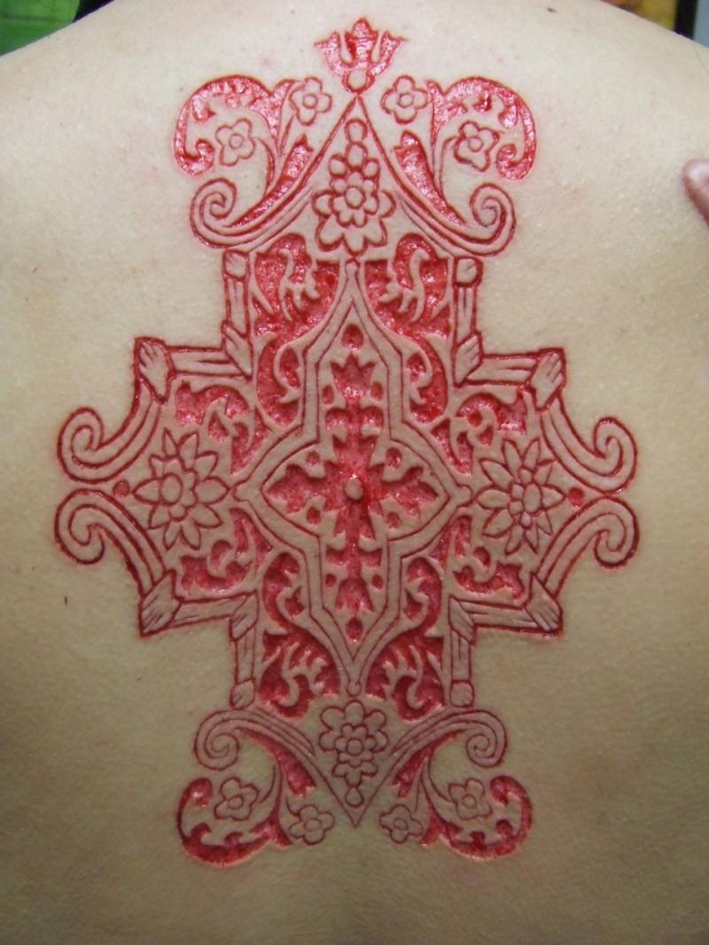 Beautiful skin scarification pattern on back tattoo