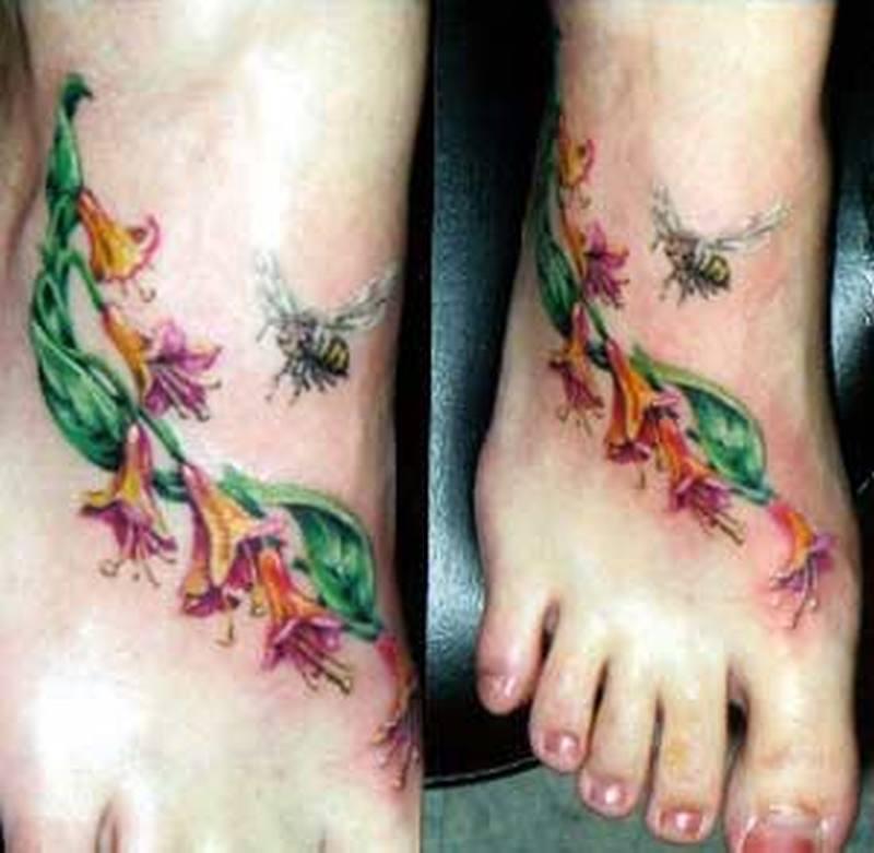 Bee flowers tattoo on feet