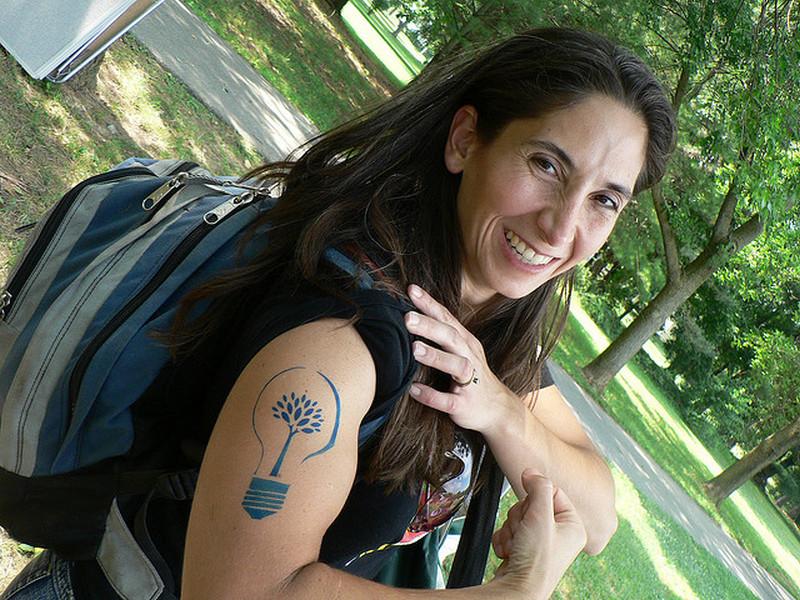 Biceps bulb tattoo for women