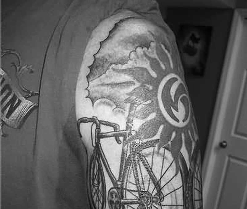 Bicycle tattoo on left shoulder