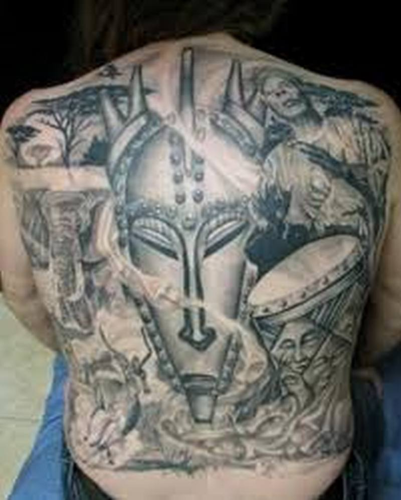 Big african tattoo on woman back