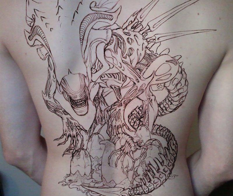 Big alien tattoo on back