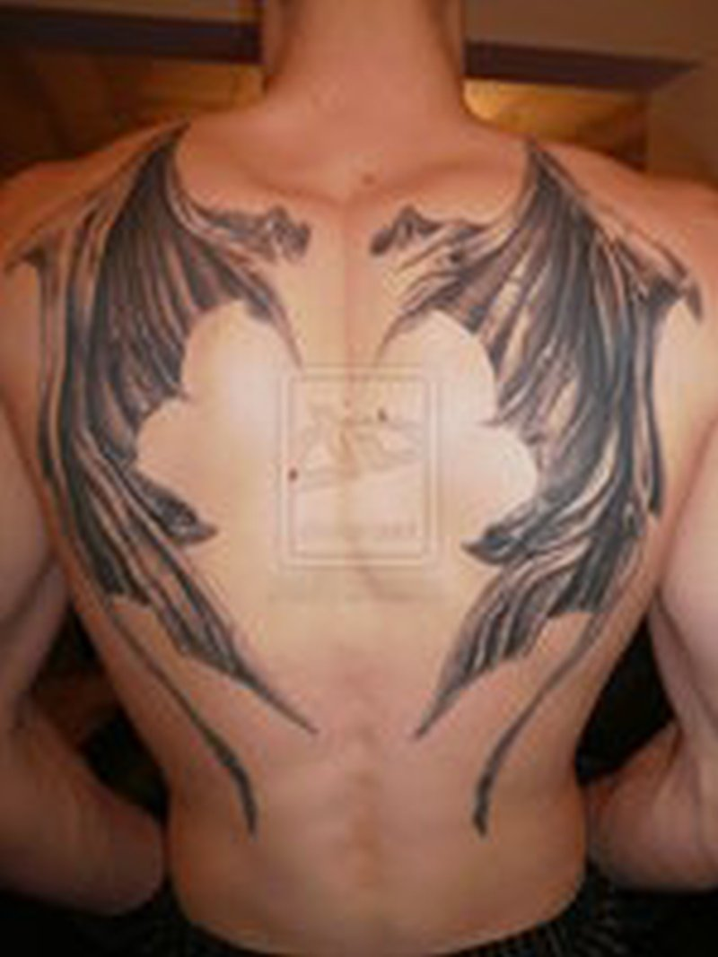Big bat wings tattoo on mans back