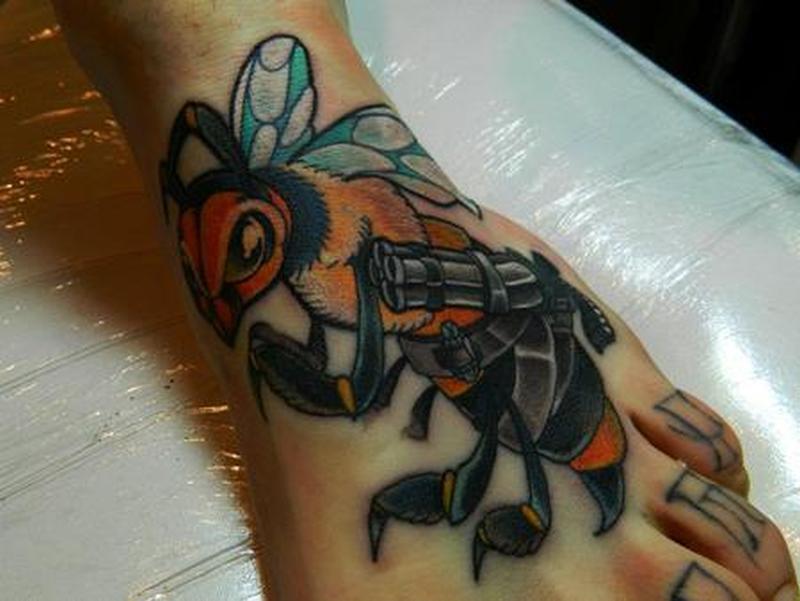 Big bee tattoo on foot