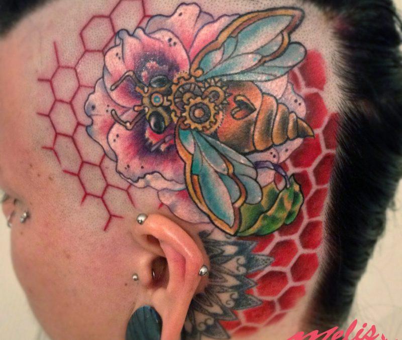 Big bee tattoo on head