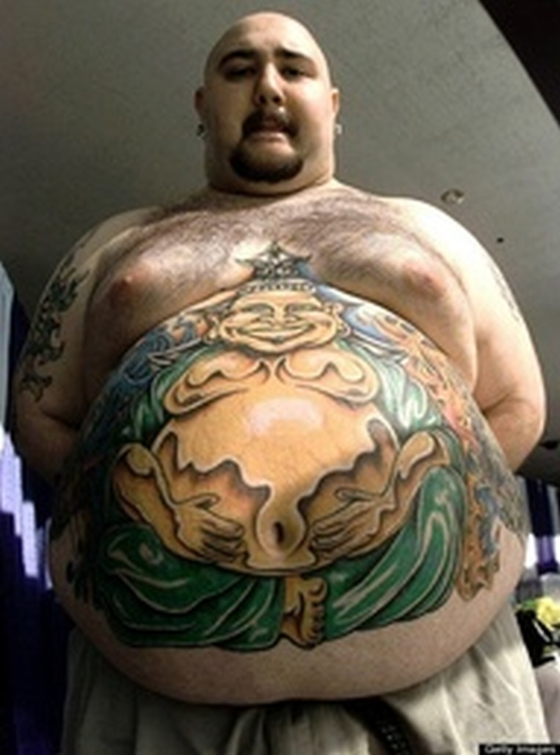 Big buddha belly button tattoo