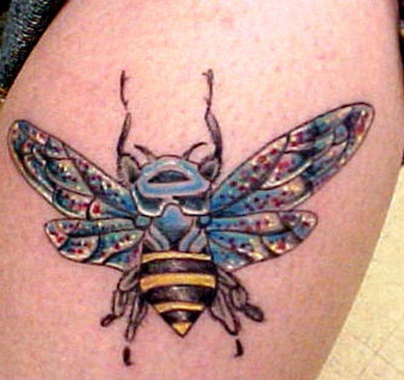 Big bumblebee tattoo on muscles
