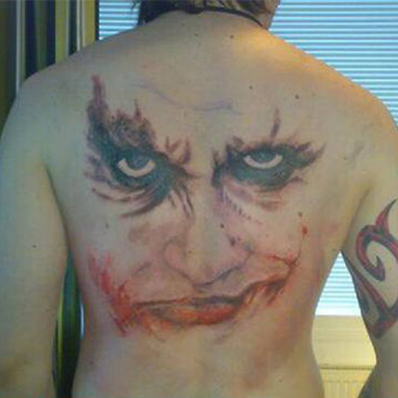 Big clown face tattoo on back