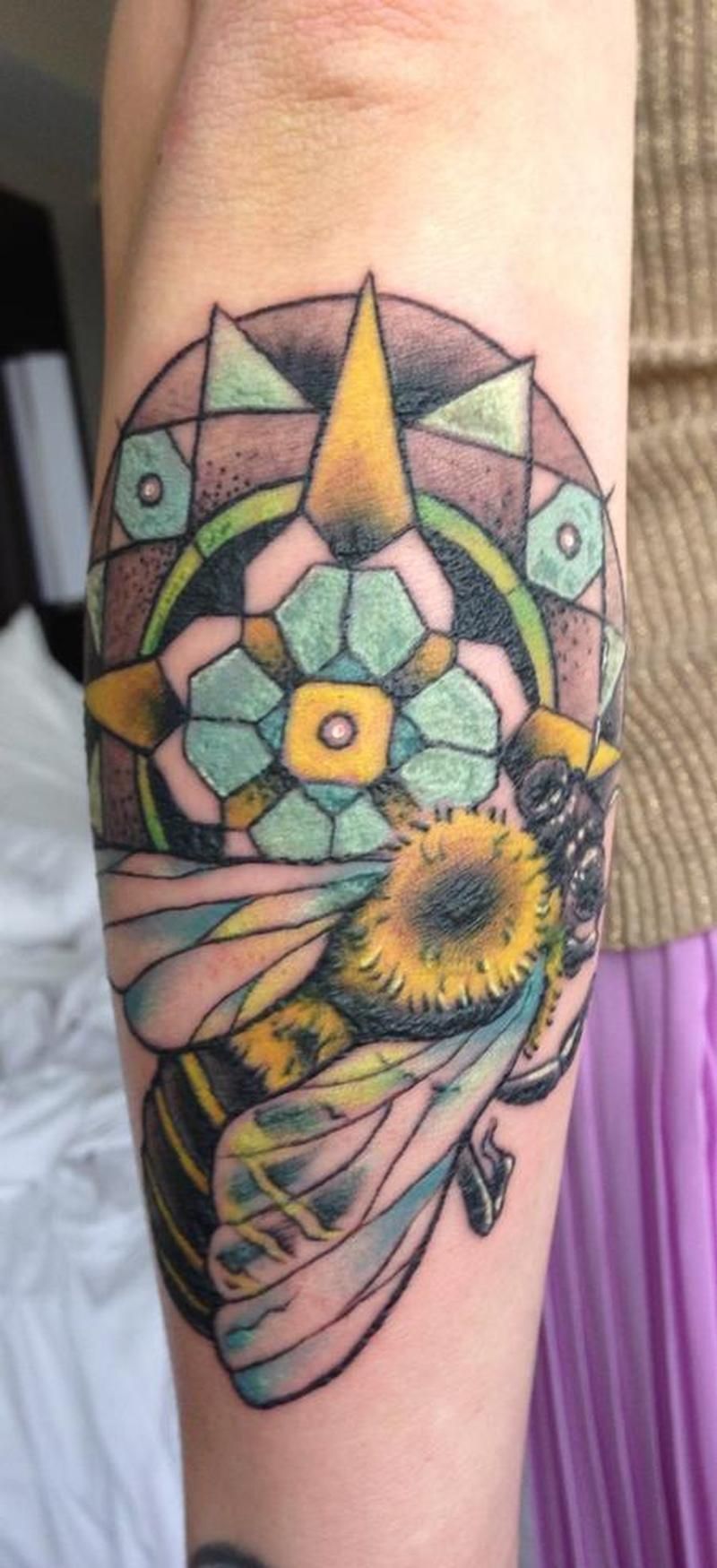 Big colorful bee tattoo on arm