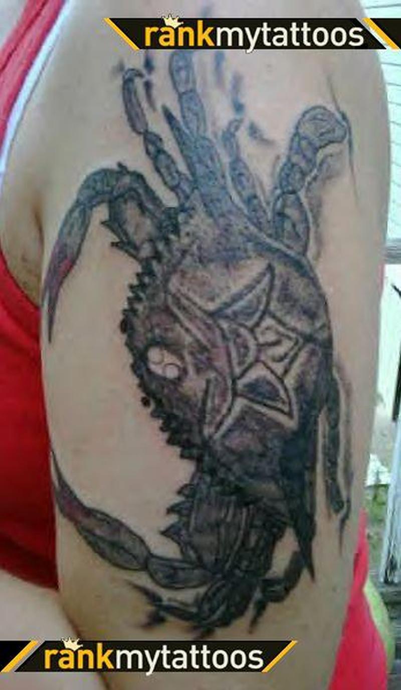 Big crab tattoo on biceps