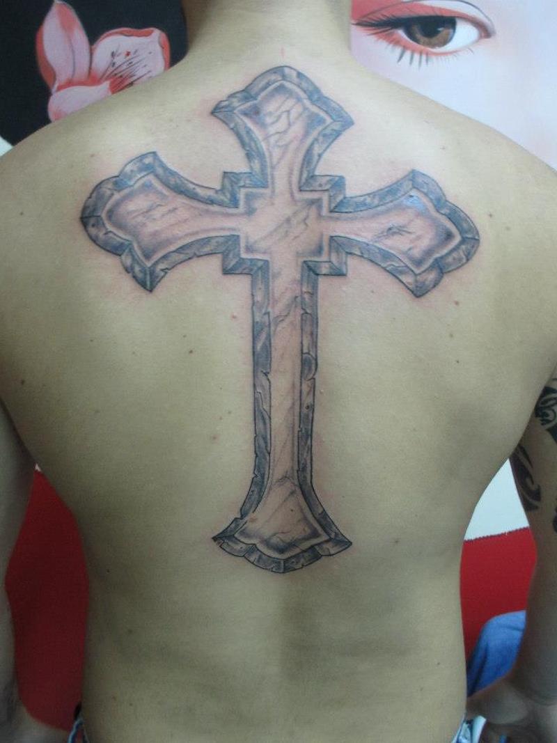 Big cross tattoo on back